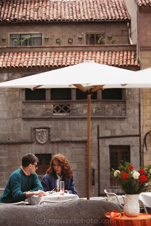 A couple at an outdoor café in Segovia, Spain.