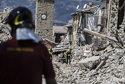 August 30, 2016 - Amatrice, Italy - Rescue Workers on August 30, 2016 in Amatrice, Italy. Italy has declared a state of emergency in the regions worst hit by Wednesday's earthquake as hopes diminish of finding more survivors. At least 290 people are now know to have died and around 400 injured with teams continuing to search the rubble of collapsed buildings. (Credit Image: © Manuel Romano/NurPhoto via ZUMA Press)