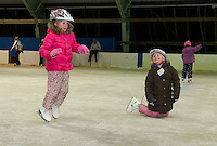 Whether standing up or falling down Sarah and Brandi Dumas were all smiles during Gilford Parks and Recreation's skating party Friday night at the Arthur Tilton Ice Rink.  (Karen Bobotas/for the Laconia Daily Sun)