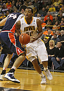 December 29 2010: Iowa Hawkeyes forward Jarryd Cole (50) drives with the ball during the first half of an NCAA college basketball game at Carver-Hawkeye Arena in Iowa City, Iowa on December 29, 2010. Illinois defeated Iowa 87-77.