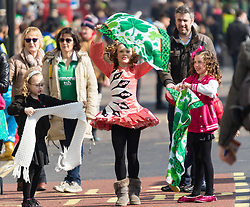 London, March 13th 2016. The annual St Patrick's Day Parade takes place in the Capital with various groups from the Irish community as well as contingents from other ethnicities taking part in a procession from Green Park to Trafalgar Square.  PICTURED: A girl dances in the street prior to the procession. ©Paul Davey<br /> FOR LICENCING CONTACT: Paul Davey +44 (0) 7966 016 296 paul@pauldaveycreative.co.uk