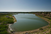 A multi-year drought has caused lake levels to drop extremely low at Lake Carl Eitling in Black Mesa State Park in the far western tip of the Oklahoma Panhandle, less than 20 miles from New Mexico.  Fishermen ar parking in what would normally be the bottom of the lake.