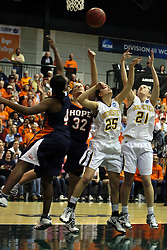 19 March 2010: Philana Greene, Erika Bruinsma,Caroline Bernal-Silva and Melissa Alwardt reach for the same loose ball. The Flying Dutch of Hope College defeat the Yellowjackets of the University of Rochester in the semi-final round of the Division 3 Women's Basketball Championship by a score of 86-75 at the Shirk Center at Illinois Wesleyan in Bloomington Illinois.
