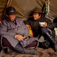 """MONGOLIA, Mishig and a Mongolian herder in a tipi of the Tsaatan """"reindeer people."""""""