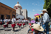 School children parade through the historic district past the Templo de San Francisco during Mexican Independence Day celebrations September 16, 2017 in San Miguel de Allende, Mexico.