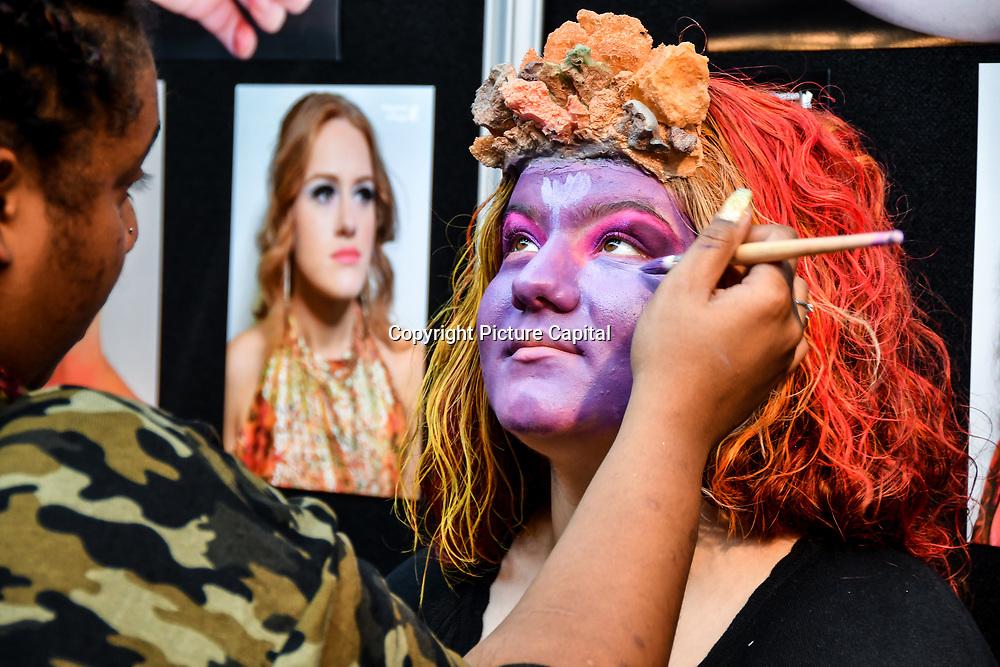 Kingston College by Artist Ashley Thomas-Doe and model/artist Oben Seyer demo at IMATS London on 18 May 2019,  London, UK.