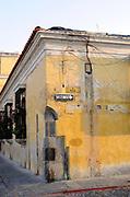 Street corner with signs for Calle de Sto Domingo and Una Via, One Way.. Antigua Guatemala, Republic of Guatemala. 02Mar14