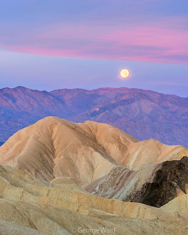 Setting Full Moon at Dawn in Golden Canyon, Death Valley National Park, California