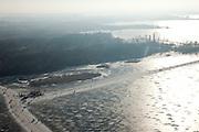 Nederland, Noord-Holland, Oud Loosdrecht, 10-01-2009; Eerste Plas tijdens schaatstocht, met stempelpost en koek en zopie tent; frozen lake during skating tour; schaats, schaatser, schaatsen, ijs, ijspret, pret, ijsbaan, natuurijs, schaatsen rijden, winter, koud, vriezen, min nul, beneden nul, koud, celsius, skating, ice skating, ice, fun, skating rink, natural, skate, snow, cold, freezing, minus zero, below zero, cold, winterlandschap, winter landscape, tocht, toertocht, koek en zopie . .luchtfoto (toeslag); aerial photo (additional fee required); .foto Siebe Swart / photo Siebe Swart