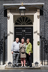 © Licensed to London News Pictures. 16/07/2013. London, UK. Julie Hilling, MP for Bolton West (R), Shirley (C) and Michael Anderson (L), the parents of Jade Anderson, who was mauled to death by dogs, stand on the steps of Number 10 after handing in a petition calling on the Government to take more action on dangerous dogs on Downing Street in London today (16/07/2013). Photo credit: Matt Cetti-Roberts/LNP