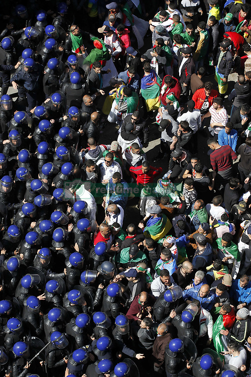 March 29, 2019 - Algiers, Algeria - Algerians protest against President Abdelaziz Bouteflika in Algiers, Algeria, 29 March 2019. Protests continue in Algeria despite Algeria's president announcement on 11 March that he will not run for a fifth Presidential term and postponement of presidential elections previously scheduled for 18 April 2019 until further notice. (Credit Image: © Billal Bensalem/NurPhoto via ZUMA Press)