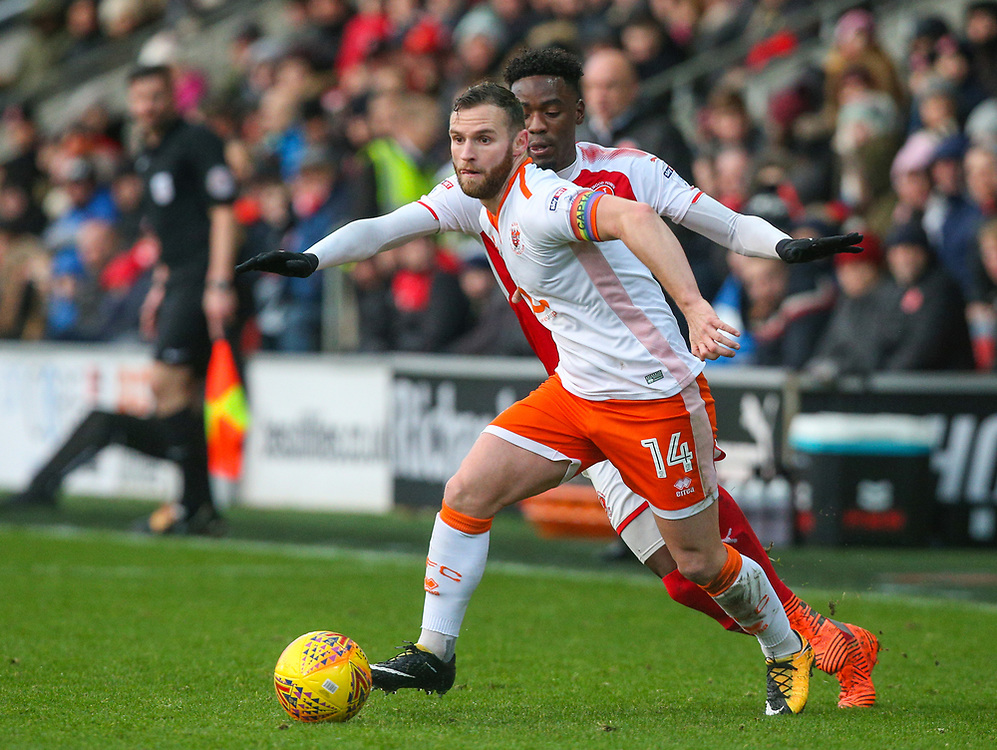 Blackpool's Jimmy Ryan gets away from Fleetwood Town's Devante Cole<br /> <br /> Photographer Alex Dodd/CameraSport<br /> <br /> The EFL Sky Bet League One - Fleetwood Town v Blackpool - Saturday 25th November 2017 - Highbury Stadium - Fleetwood<br /> <br /> World Copyright © 2017 CameraSport. All rights reserved. 43 Linden Ave. Countesthorpe. Leicester. England. LE8 5PG - Tel: +44 (0) 116 277 4147 - admin@camerasport.com - www.camerasport.com