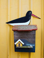 Detail of ornate mailbox decorated with seagull on house in Sweden
