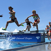 Competitors in action at the water jump in the Women's 3000m Steeplechase during the Diamond League Adidas Grand Prix at Icahn Stadium, Randall's Island, Manhattan, New York, USA. 13th June 2015. Photo Tim Clayton