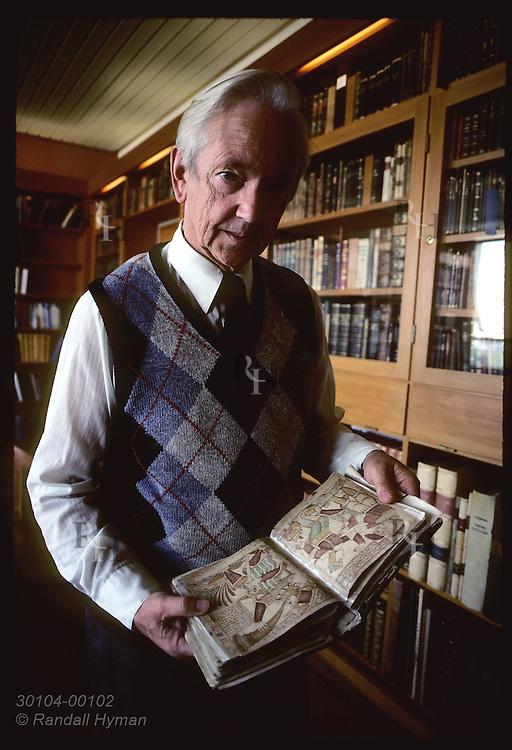 Jonas Kristjansson, Arni Magnusson Institute's director, holds 18th-century copy of Snorra Edda Iceland