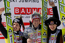 Second placed in  Ski Jumping World Cup overall classification Simon Ammann of Switzerland, overall winner Thomas Morgenstern of Austria  and third placed Adam Malysz of Poland celebrate at flower ceremony after the Flying Hill Individual at 4th day of FIS Ski Jumping World Cup Finals Planica 2011, on March 20, 2011, Planica, Slovenia. (Photo by Vid Ponikvar / Sportida)