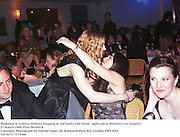 Madonna & Juliette Hohnen hugging at theVanity Fair Oscar  night party, Mortons, Los Angeles. 23 March 1988. Film 98169f18<br /> Copyright Photograph by Dafydd Jones<br /> 66 Stockwell Park Rd. London SW9 0DA<br /> Tel. 0171 733 0108