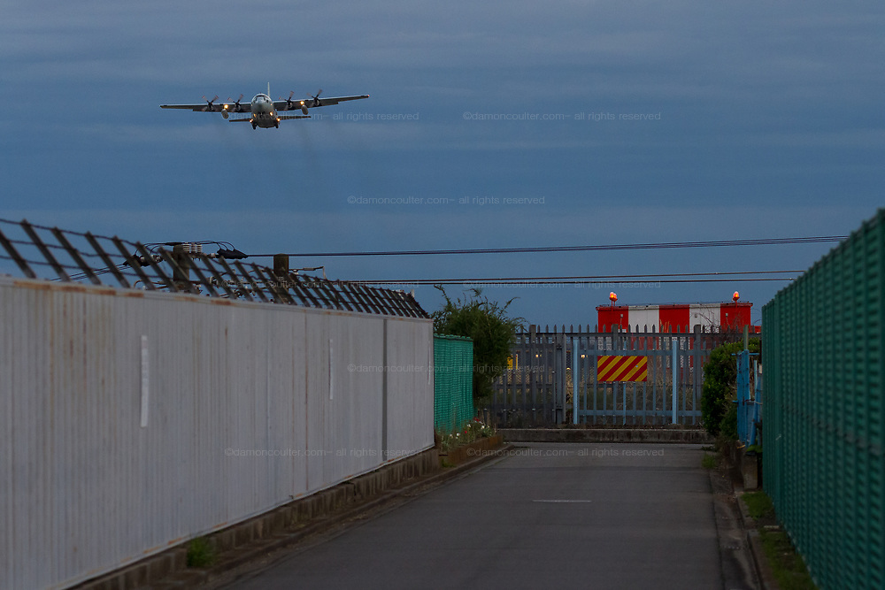 A lockheed C130 Hercules transport aircraft rakes off from Naval Air Facility, Atsugi, airbase near Yamato, Kanagawa, Japan. Thursday April 11th 2019