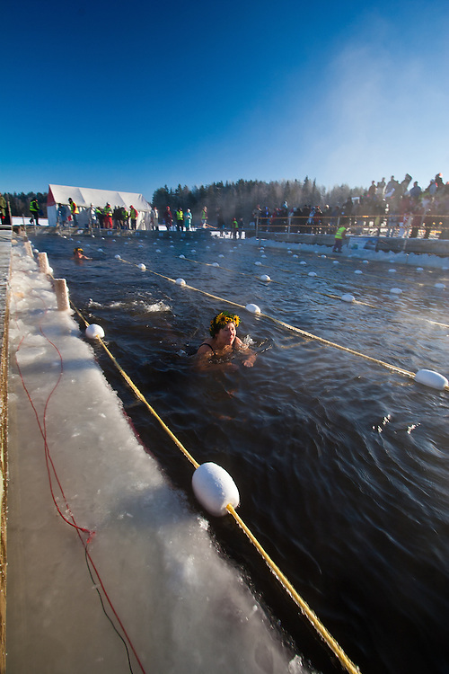 The competitors Marja-Liisi Ukkonen and Paula Kinnunen performing in Finnish Ice Swimming Championships in Ellivuori, Finland.