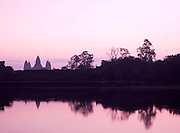 The silhouette of Angkor Wat seen across the moat at sunrise, Siem Reap Province, Cambodia