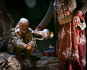 """Lunch of salty milk tea and yoghurt inside a shepherd home. Life in Baiqara, a Wakhi High pasture inhabited for about 6 months of the year, from May until October. Guiding and photographing Paul Salopek while trekking with 2 donkeys across the """"Roof of the World"""", through the Afghan Pamir and Hindukush mountains, into Pakistan and the Karakoram mountains of the Greater Western Himalaya."""