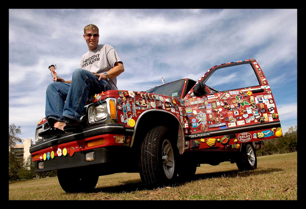 Jan 4th, 2006. New Orleans, Louisiana. Fridge magnet man Chris Cressionnie and his 1994 Chevy Blazer. Chris traversed New Orleans after the hurricane collecting fridge magnets from all the discarded fridges left abandoned and stinking in the streets. He now has a collection of thousands of magnets and residents continue to donate magnets as do people from all across the USA.