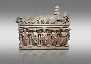 """Roman relief sculpted sarcophagus with kline couch lid with a reclining male figuer depicted, """"Columned Sarcophagi of Asia Minor"""" style typical of Sidamara, 3rd Century AD, Konya Archaeological Museum, Turkey. Against a grey background .<br /> <br /> If you prefer to buy from our ALAMY STOCK LIBRARY page at https://www.alamy.com/portfolio/paul-williams-funkystock/greco-roman-sculptures.html . Type -    Konya     - into LOWER SEARCH WITHIN GALLERY box - Refine search by adding a subject, place, background colour, museum etc.<br /> <br /> Visit our ROMAN WORLD PHOTO COLLECTIONS for more photos to download or buy as wall art prints https://funkystock.photoshelter.com/gallery-collection/The-Romans-Art-Artefacts-Antiquities-Historic-Sites-Pictures-Images/C0000r2uLJJo9_s0"""