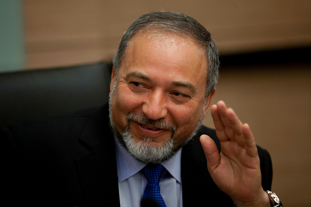 """Israel's Foreign Minister Avigdor Lieberman gestures during a meeting with representatives of the """"Suckers' Tent"""" campaign (not pictured), promoting mandatory military service for all sectors of Israeli society, at the Knesset, Israel's parliament in Jerusalem, on May 3, 2012."""