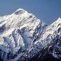 Nilgiri Peak towers above the Thak Khola valley, north of Annapurna in Nepal.