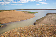 Confluence of Barthorp's Creek tidal tributary near mouth of River Ore, Shingle Street, Hollesley, Suffolk, England, UK