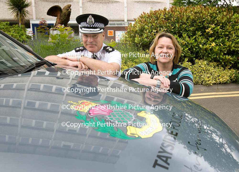 Tayside Police Western Division Commander Chief Superintendent Craig Suttie pictured with Brenda Bissett from Perth's Auto Services Ltd who have donated a Ford Mondeo to the Crime Reduction Unit in Perth & Kinross<br /> Picture by Graeme Hart.<br /> Copyright Perthshire Picture Agency<br /> Tel: 01738 623350  Mobile: 07990 594431