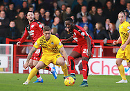 Crawley Town striker Roarie Deacon shields the ball from Bristol Rovers defender Jamie Clarke during the Sky Bet League 2 match between Crawley Town and Bristol Rovers at the Checkatrade.com Stadium, Crawley, England on 21 November 2015. Photo by Bennett Dean.