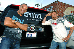 File photo : French designer Christian Audigier and Johnny Hallyday pose together a the end of a Photoshoot for clothing fashion line 'SMET' held in a Mar Vista tuning garage in Los Angeles, CA, USA on July 28, 2007. PHoto by Lionel Hahn/ABACAPRESS.COM