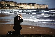 Saint Laurent sur mer, France, Jun 06, 1995, A ranger prays at Omaha beach on the D-day 50th anniversary.