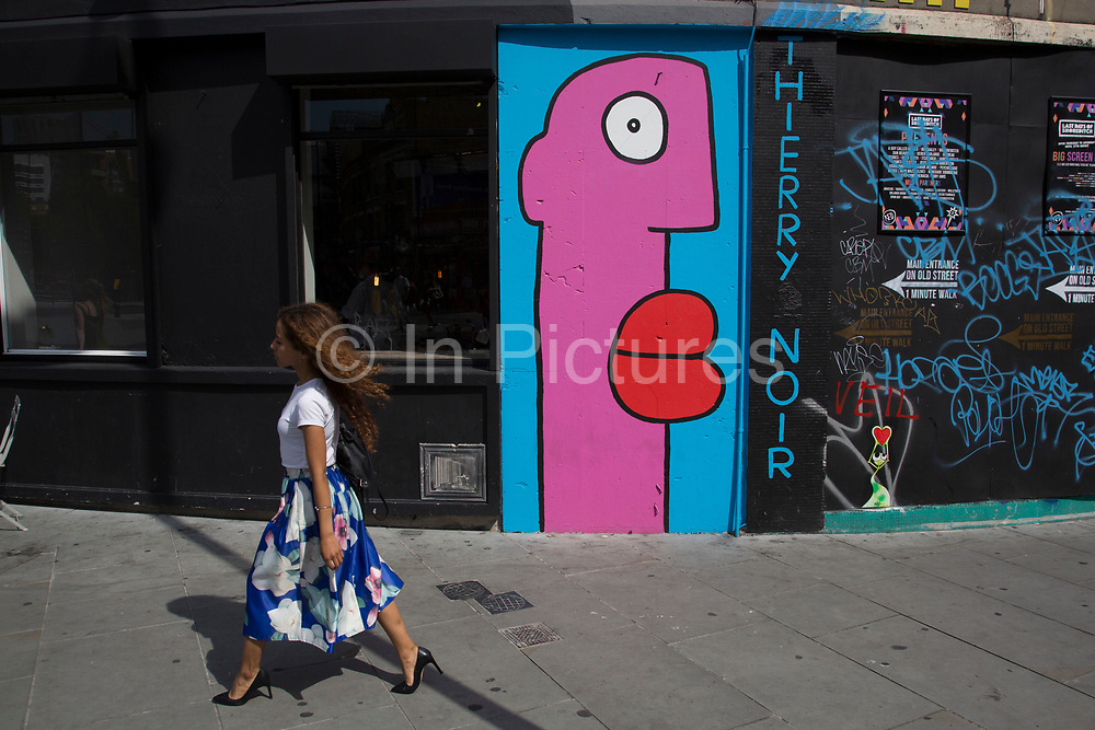 Street art by Thierry Noir in Shoreditch, East London, United Kingdom. Street art in the East End of London is an ever changing visual enigma, as the artworks constantly change, as councils clean some walls or new works go up in place of others. While some consider this vandalism or graffiti, these artworks are very popular among local people and visitors alike, as a sense of poignancy remains in the work, many of which have subtle messages.