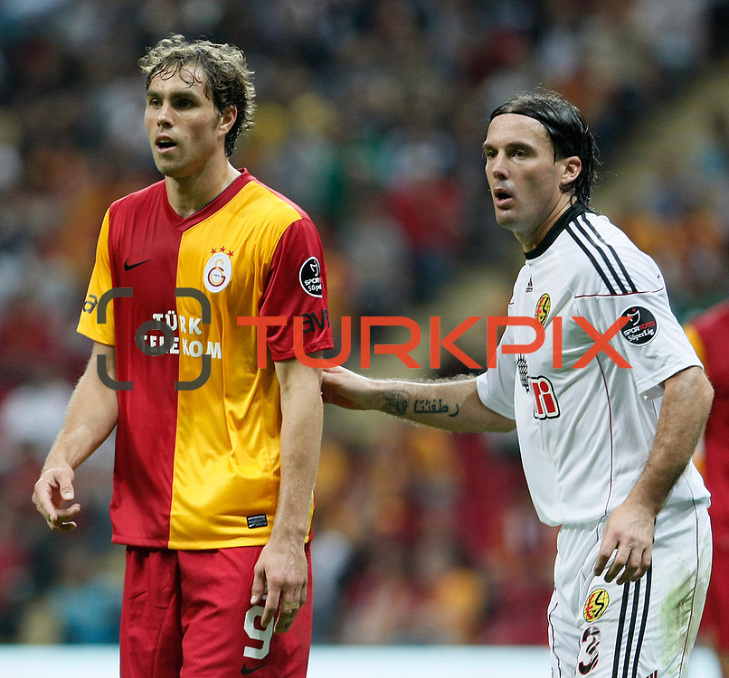 Galatasaray's Johan ELMANDER (L) and Eskisehirspor's Safet NADAREVIC (R) during their Turkish Super League soccer match Galatasaray between Eskisehirspor at the TT Arena at Seyrantepe in Istanbul Turkey on Monday, 26 September 2011. Photo by TURKPIX