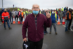 © Licensed to London News Pictures 23/12/2020.        Manston, UK. This trucker says he is the protest leader. Hundreds of angry truckers have blockaded the A299 at Manston Airport, Kent this morning in a mass protest. France have closed its borders to all freight traffic because of the new Coronavirus strain. Photo credit:Grant Falvey/LNP