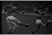 All Ireland Junior Football Final, Kerry v Wicklow..N. Carthy (left), Wicklow Full Forward, gets in his kick at goal but it is blocked by M. Keane of Kerry..14.09.1969.