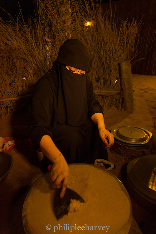 Woman making traditional flat bread, United Arab Emirates