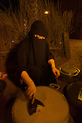 Woman making traditional flat bread, United Arab Emirates