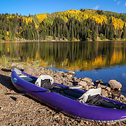 Fall foliage begins to show on the shores of Lost Lake Slough near Kebler Pass, Colorado