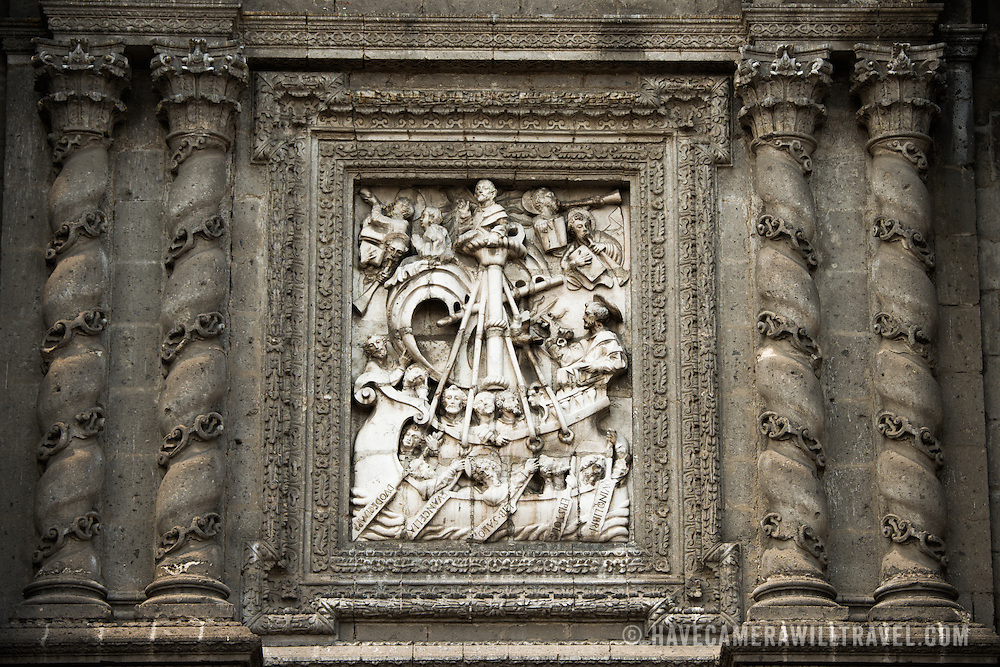 The southern facade of the Metropolitan Tabernacle features ornate depictions of the Eucharist with images of the Apostles, Church Fathers, saints who founded religious orders, martyrs as well as scenes from the Bible. Adjacent to the Metropolitan Catheral, facing the Zocalo, the Metropolitan Tabernacle (Spanish: Sagrario Metropolitana) was built by Lorenzo Rodríguez in the Baroque style between 1749 and 1760. It was designed to to house the archives and vestments of the archbishop. It also functioned and continues to function as a place to receive Eucharist and register parishioners.