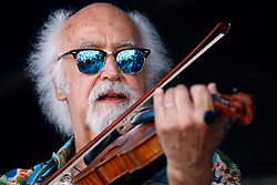 24 April 2016. New Orleans, Louisiana.<br /> The New Orleans Jazz and Heritage Festival. <br /> BeauSoleil with cajun fiddler Michael Doucet.<br /> Photo; Charlie Varley/varleypix.com