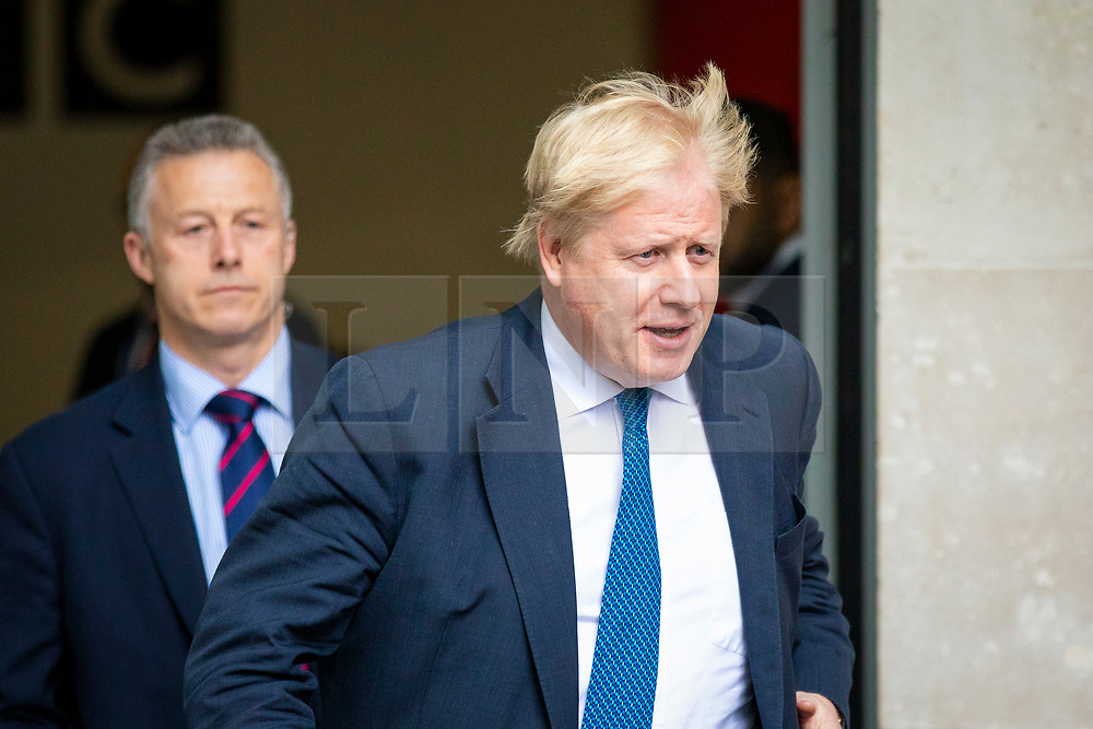 © Licensed to London News Pictures. 15/04/2018. London, UK. Foreign Secretary BORIS JOHNSON (R) leaves BBC Broadcasting House after appearing on the Andrew Marr Show. Photo credit: Rob Pinney/LNP