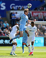Peter Crouch of Stoke city © jumps for a header. Premier league match, Swansea city v Stoke City at the Liberty Stadium in Swansea, South Wales on Saturday 22nd April 2017.<br /> pic by Andrew Orchard, Andrew Orchard sports photography.