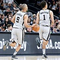 02 April 2017: San Antonio Spurs guard Tony Parker (9) brings the ball up court next to San Antonio Spurs guard Kyle Anderson (1) during the San Antonio Spurs 109-103 victory over the Utah Jazz, at the AT&T Center, San Antonio, Texas, USA.