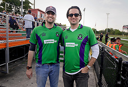 09 May 2015. New Orleans, Louisiana.<br /> WDSU's Travers and Fletcher Mackel at the New Orleans Jesters season opener at the Pan American Stadium against Jacksonville United. Jacksonville win 2-1 in a tense game.<br /> Photo; Charlie Varley/varleypix.com