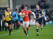 Saracens Ben Spencer runs 3/4 of the length of the pitch to score as Sale Sharks full-back Mike Haley gives chase during the Aviva Premiership match Sale Sharks -V- Saracens at The AJ Bell Stadium, Salford, Greater Manchester, England on November  20  2016. (Steve Flynn/IOS via AP)