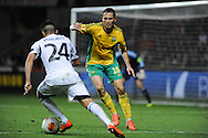 Kuban Krasnodar's Maksim Zhavnerchik challenges Álex Pozuelo of Swansea City.<br /> UEFA Europa league match, Swansea city v FC Kuban Krasnodar at the Liberty Stadium in Swansea, South Wales on Thursday 24th October 2013. pic by Phil Rees, Andrew Orchard sports photography,