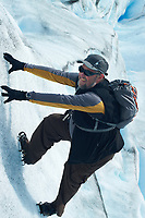 Thom Hogan climbing Perito Moreno Glacier without any ropes. Image taken with a Nikon D3s camera and 50 mm f/1.4 lens (ISO 200, 50 mm, f/7, 1/200 sec).